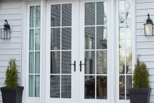 elegant white French doors with black handles are a very stylish and cool solution for any entrance, they look amazing and can be styled in many ways