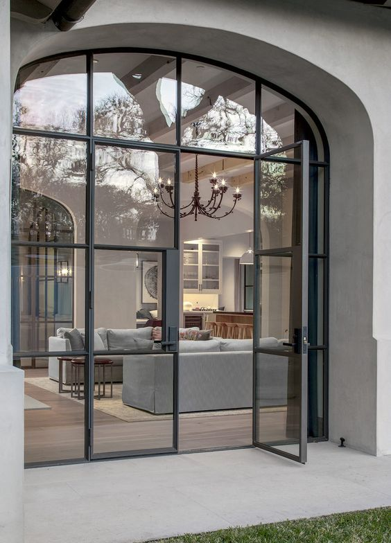 gorgeous glass French doors in black are a very refined and chic solution for a luxurious contemporary space and they look wow