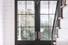 lovely black French doors are an amazing fir for a rustic space and entrance and are timeless and chic, they can fit many other styles, too