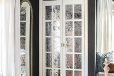 mirrored French doors leading to a closet are gorgeous for a refined and elegant space and that mirror touch is lovely