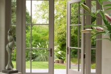 modern and chic grey French doors with an edgy twist bring much light inside, add a refined feel and make the space look beautiful