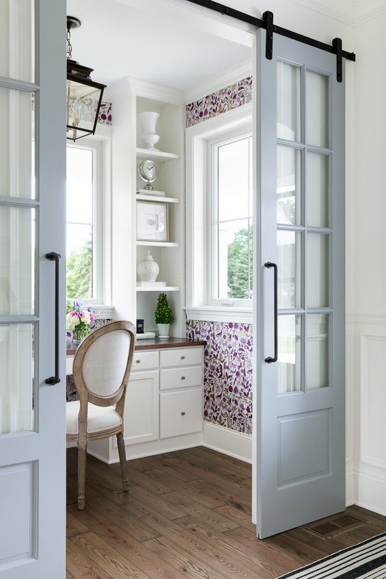 powder blue sliding French doors are a great way to add chic to the interior and save space at the same time