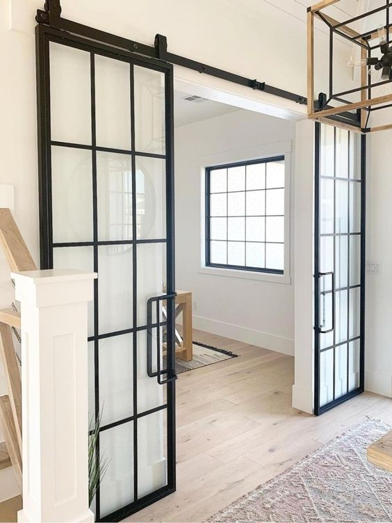 sliding black French doors with handles are perfect for rustic or farmhouse spaces and won't take any space at all