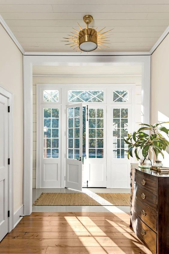 such white French doors with panes are wonderful for any space and perfectly fit this modern and elegant room