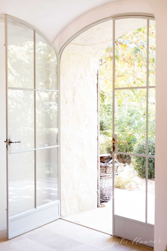 very delicate white arched Frech doors are gorgeous for any space, they look amazing in many areas, both indoors and outdoors