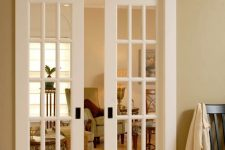white French sliding doors will add a refined touch and a timeless look to the interor subtly separating the spaces