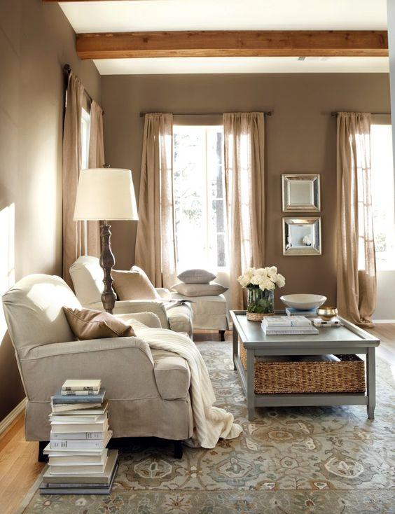 a cozy farmhouse living room design with a taupe color scheme