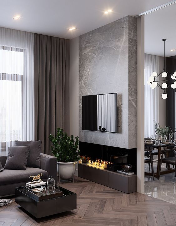 a refined modern living room with a taupe sofa, curtains and a fireplace unit, a black coffee table and a marble accent wlal