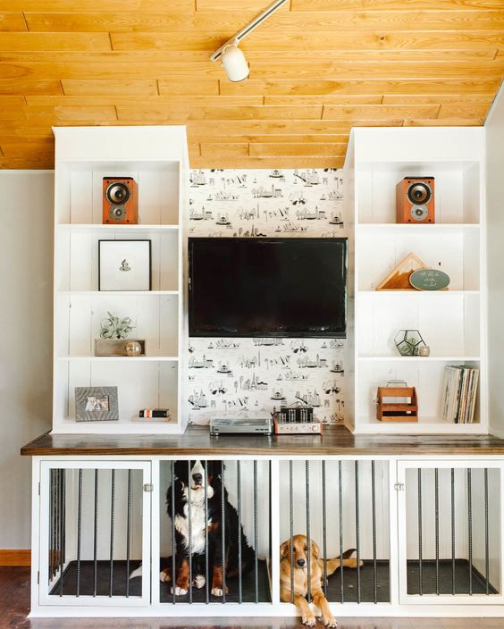 a TV unit with open shelves and a large dog kennel built in into the lower part of it is a cool idea for your space