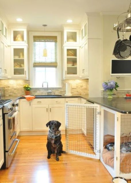a cozy neutral kitchen with a farmhouse feel, a faux stone backsplash and a dog kennel with a mattress that is enough for two pets