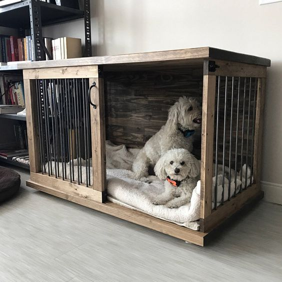 a cozy stained dog crate with a sliding door and mattresses for two dogs is a lovely idea for a rustic room