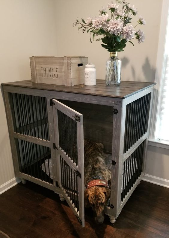 a farmhouse kennel with a dark countertop doubles as a console table and matches a farmhouse space