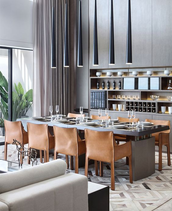 a formal contemporary dining room with a dark stained dining table, leather chairs, cone pendant lamps is a lovely idea
