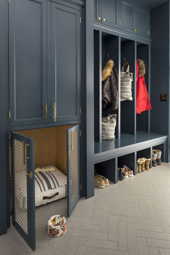 a graphite grey entryway with open and closed storage units and with a built-in dog kennel with a striped mattress