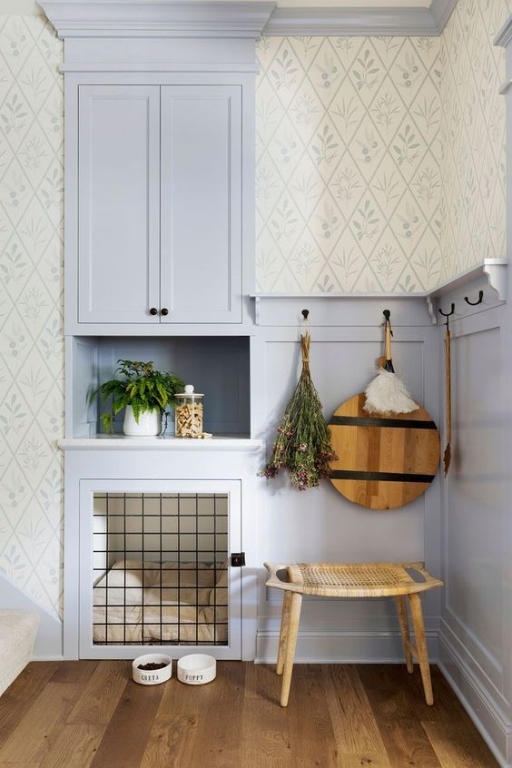 a lilac nook with paneling, a built-in cabinet, a built-in dog crate with a soft cushion is a lovely idea for a rustic space