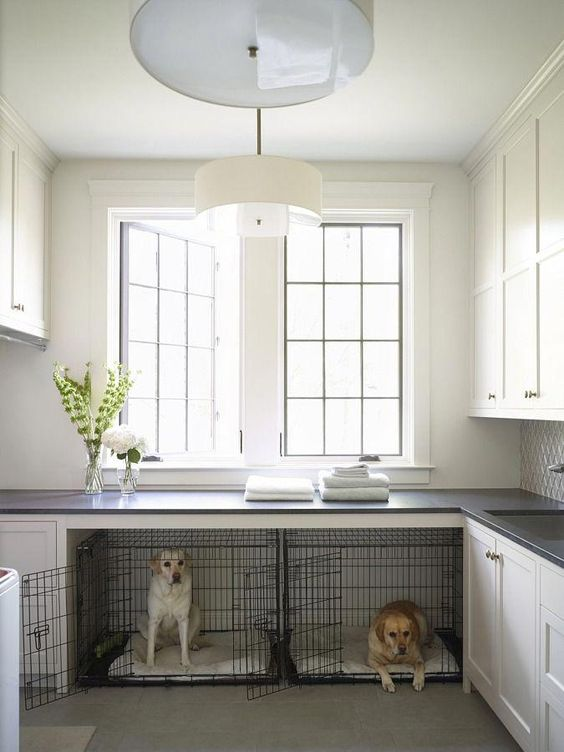 a neutral laundry room with two cabinets turned into a double dog crate with neutral mattresses is a very cool and fresh idea