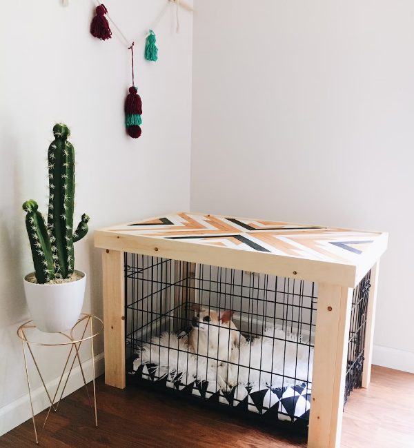 a pretty mid-century modern dog kennel with a geometric pattern on top and a geo printed mattress