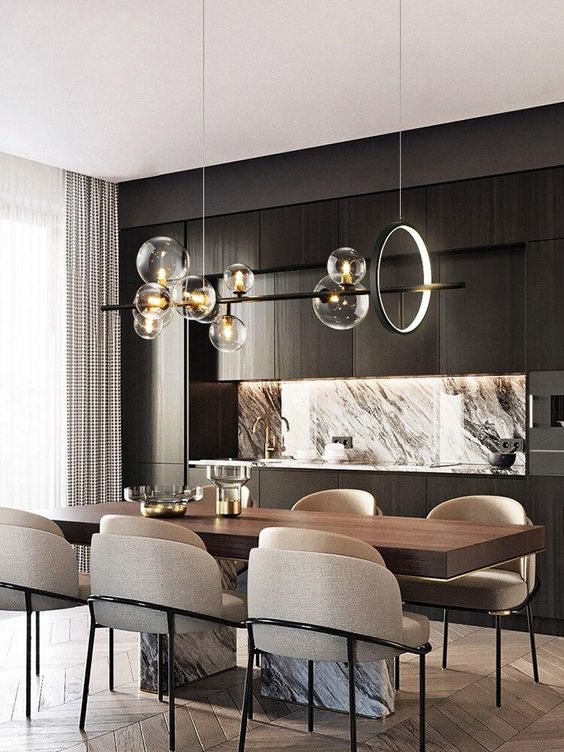 a refined contemporary dining space wiht a wood and marble table, neutral rounded chairs, a chic chandelier with a light circle