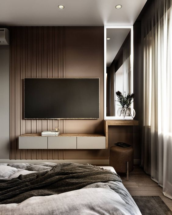 a refined taupe bedroom with paneling, a floating storage unit and a TV, a leather stool and a comfortable bed is amazing