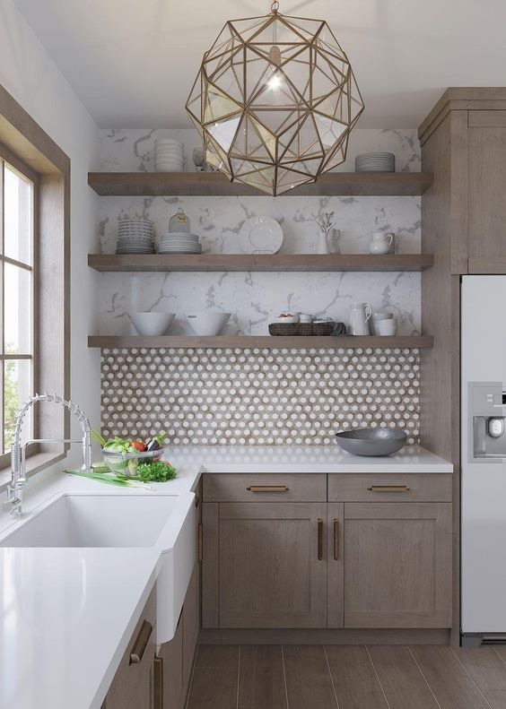 a refined taupe kitchen with a penny tile backsplash, open shelves, white stone countertops and a faceted pendant lamp is chic