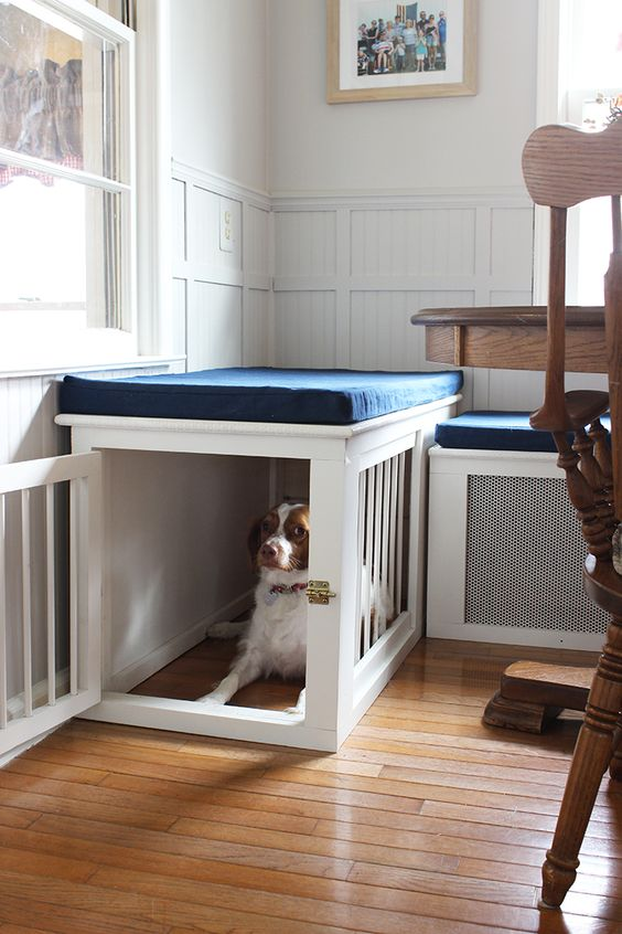 a small and cool dog crate with a cushion on top to use it as a daybed or as an additional seat is a lovely solution