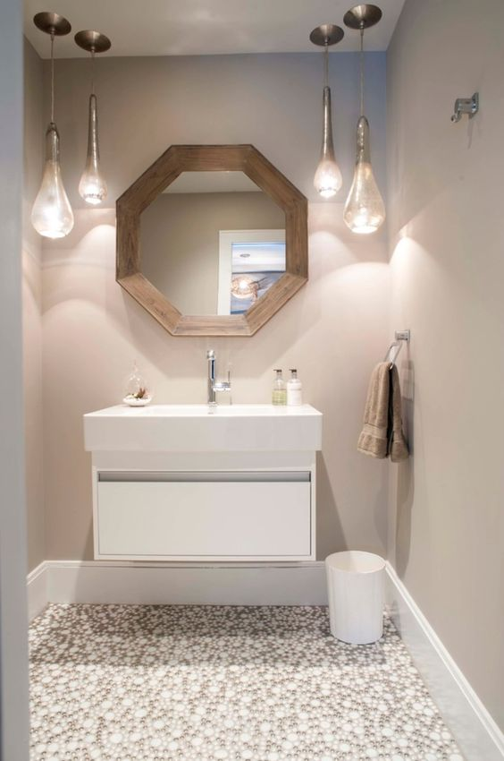 a modern powder room with a floating vanity