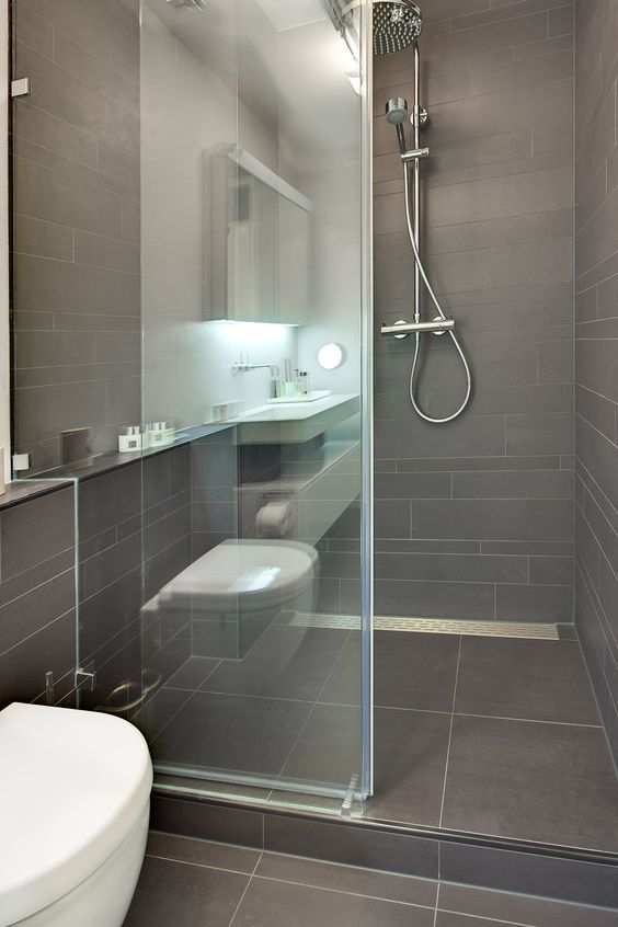 a small modern bathroom clad with taupe tiles, with chromatic fixtures and white appliances is a stylish and cool idea to rock