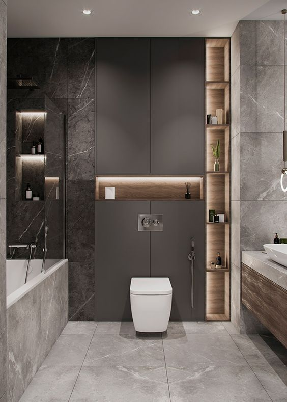a sophisticated grey bathroom with a taupe sleek panel, built-in lights, white appliances and marble and stone tiles is amazing