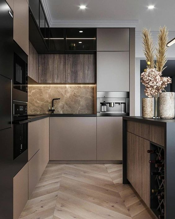 a sophisticated taupe contemporary kitchen with dark stained and taupe cabinets, grey marble and black fixtures plus black built-in appliances