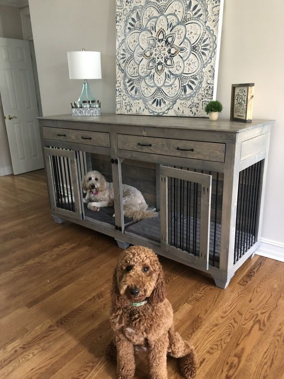 a whitewashed farmhouse dog kennel with doors and with drawers doubles as a console table in the room