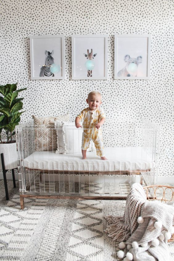 a small gallery wall looks nice in a nursery
