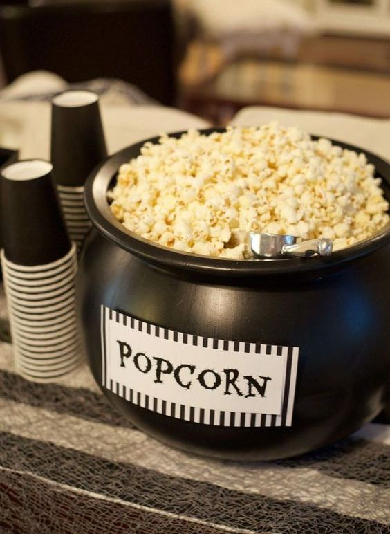 a black cauldron with popcorn is a cool way to serve this treat and it's very Halloween-inspired and cool