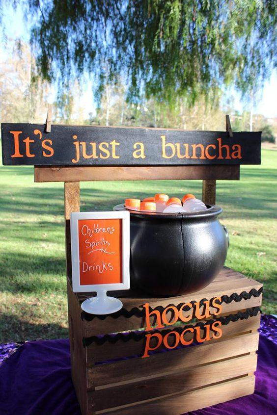 a cauldron filled with drink bottles is a cool idea for a kids' Halloween party, it can be also used to serve sweets