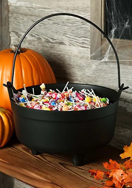 a cauldron with sweets and candies is a perfect solution for Halloween, it can be placed on the porch to treat all guests