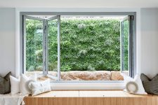 21 a folding window with a built-in storage daybed with lots of pillows and a greenery view is a gorgeous idea for a modern space