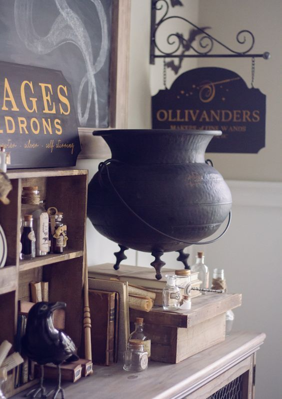 beautiful and geeky Halloween decor with an elegant cauldron, a sign, some apothecary tubes and a blackbird for Harry Potter fans