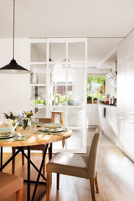 a beautiful French glass pocket door is perfect for separating a kitchen and a dining room and still make them not so divided