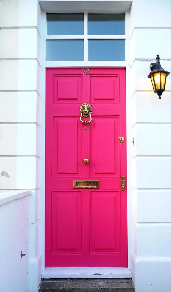 a bold fuchsia front door with vintage refined detailing is a cool idea to make a color statement at once and refresh the entrance with color