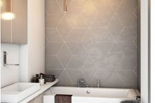 a contemporary bathroom with greige geo tiles and a floor, a built-in vanity, a built-in tub a mirror cabinet and tube lighting