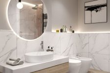 a contemporary greige bathroom clad with white marble tiles, a floating vanity, white appliances and neutral chromatic fixtures, pendant bulbs