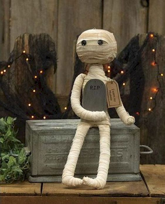 a cute and scary mini mummy decoration with a tombstone is a perfect idea for Halloween