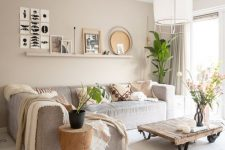 a living room with a simple ledge gallery wall