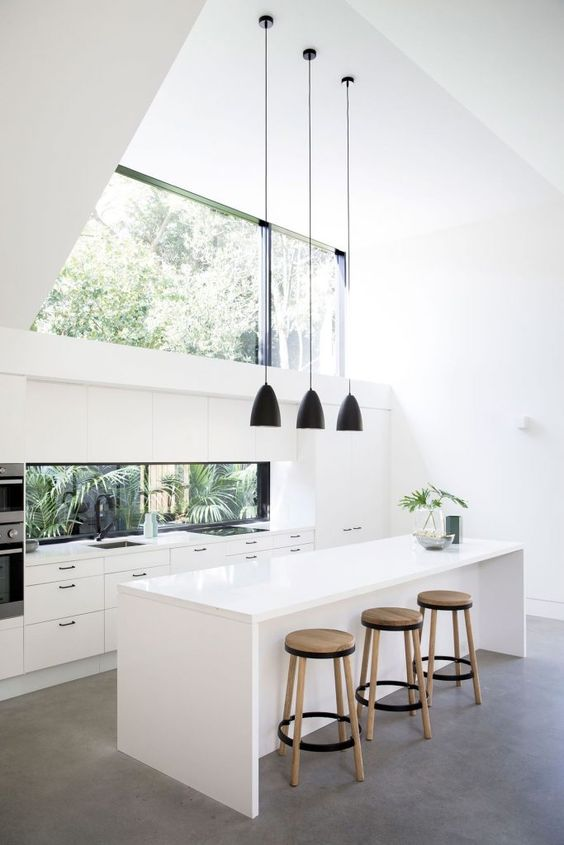 a double height ceiling is taken advantage with the help of a large window-like skylight