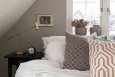 a smart attic bedroom design in neutral tones