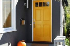 simple pumpkins makes a front porch looks perfect at fall