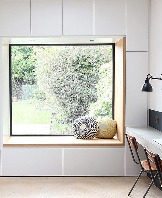 a minimalist windowsill reading nook with drawers for storage under it   you can store your books there
