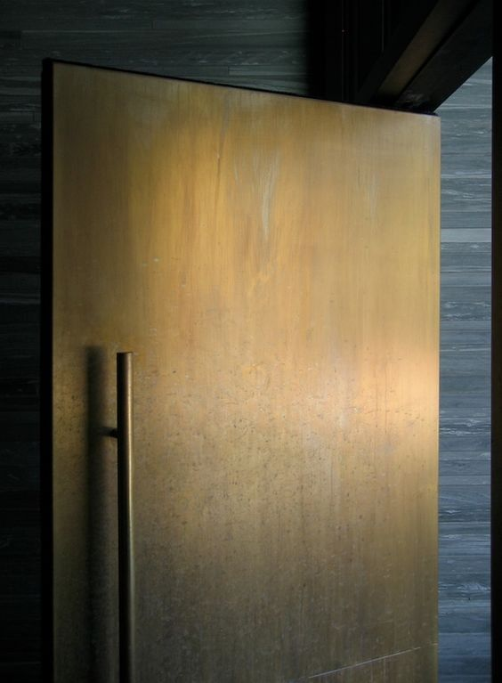 a modern weathered metal front door is a chic and bold statement in an unexpected color, choose it for a modern home