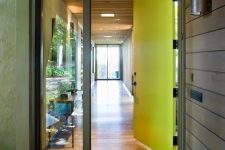 a neon yellow metal front door plus a window is a cool idea for a modern or contemporary home, and its color is amazing