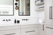 a neutral bathroom with greige cabinetry, white stone countertops and black fixtures, mirrors in black frames is a cool and stylish space