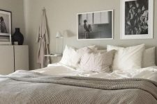 a soothing greige bedroom with neutral furniture, floating nightstands, a mini gallery wall and neutral and white textiles is very welcoming
